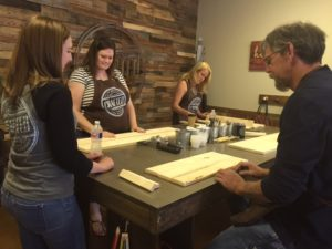 Crafted workshop participants begin a home décor project. Courtesy Crafted.