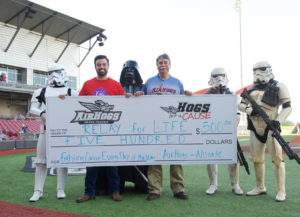 Bill Gonsiorek, representing Allstate, seen in the AirHogs uniform with a generous donation. Photo credit Jason Waite DFWMAG.