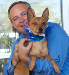 Rep. Rodney Anderson poses with Maverick at Prairie Paws adoption center in Grand Prairie. (Jason Waite Photography)